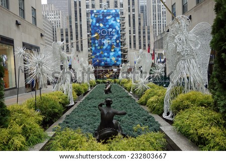 NEW YORK CITY - NOV 16: The 2014 Rockefeller Center Christmas Tree will be lit for the first time on Wednesday, December 3 with live performances from 7-9 PM,at Rockefeller Plaza in New York City. - stock photo