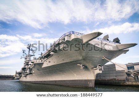 "NEW YORK CITY - NOVEMBER 23, 2013: navy ship USS Intrepid,  also known as The Fighting ""I"". Decommissioned in 1974, in 1982 Intrepid became the foundation of the Intrepid Sea, Air & Space Museum. - stock photo"