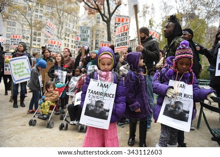 NEW YORK CITY - NOVEMBER 22 2015: Stop Mass Incarcerations Network sponsored a children's march on the anniversary of Tamir Rice's death at the hands of the Cleveland police. - stock photo