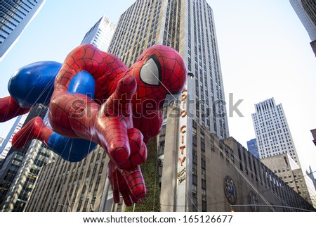 NEW YORK CITY - NOVEMBER 28 2013: Thanksgiving in New York City was celebrated by the 87th annual Macy's Thanksgiving Day Parade. Spiderman passes Radio City Music Hall November 28 2013 New York City - stock photo