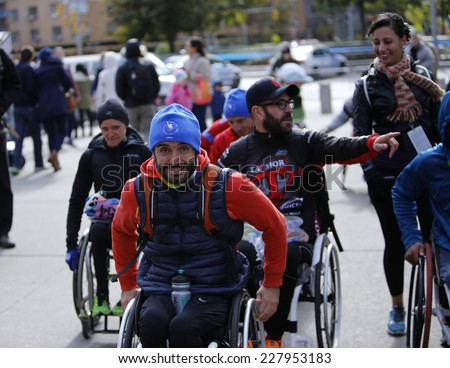 NEW YORK CITY - NOVEMBER 2 2014: the 43rd annual New York City Marathon saw more than 50,000 entrants run through all five boroughs. Wheelchair division finishers exultant after the race - stock photo