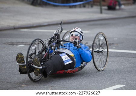NEW YORK CITY - NOVEMBER 2 2014: the 43rd annual NYC Marathon saw more than 50,000 entrants race through all five boroughs. Wheelchair division competitor passes mile four in Brooklyn - stock photo