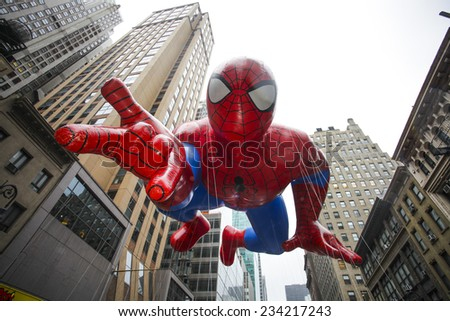 NEW YORK CITY - NOVEMBER 27 2014: the 88th annual Macy's Thanksgiving Day parade stretched from Manhattan's Upper West Side to Herald Square, viewed by 350,000 spectators. Spiderman balloon - stock photo