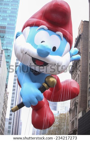 NEW YORK CITY - NOVEMBER 27 2014: the 88th annual Macy's Thanksgiving Day parade stretched from Manhattan's Upper West Side to Herald Square, viewed by 350,000 spectators. Papa Smurf balloon - stock photo