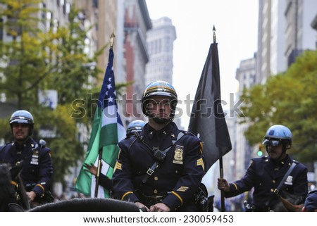 NEW YORK CITY - NOVEMBER 11 2014: the 95th annual Veteran's Day parade along Fifth Avenue is the largest Nov 11 celebration in the United States. NYPD mounted police at fore of parade - stock photo