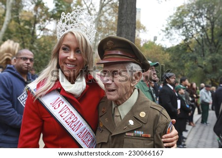 NEW YORK CITY - NOVEMBER 11 2014: the 95th annual Veteran's Day parade along Fifth Avenue is the largest Nov 11 celebration in the United States. Miss Veteran America, Allaina Guitron, with veteran - stock photo