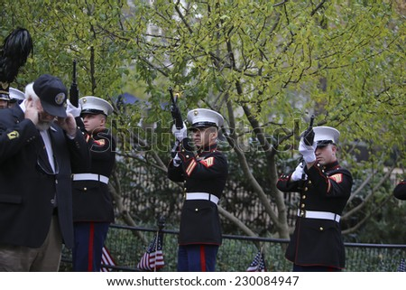 NEW YORK CITY - NOVEMBER 11 2014: the 95th annual Veteran's Day parade along Fifth Avenue is the largest Nov 11 celebration in the United States. Firing salute during wreath laying - stock photo