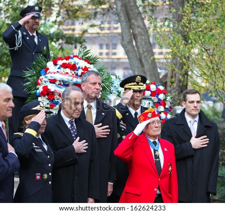 NEW YORK CITY - NOVEMBER 11 2013: Veterans' Day was marked by a ceremonial wreath laying at the Eternal Light Monument in Madison Square Park & parade on Fifth Avenue November 11 2013 in New York City - stock photo