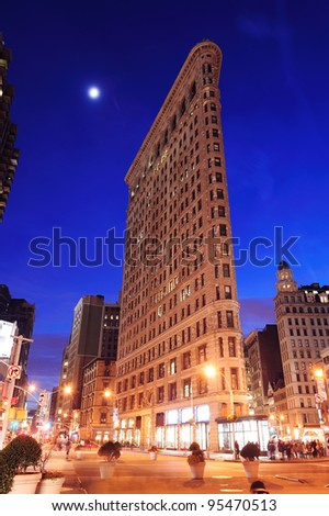 NEW YORK CITY, NY - DEC 30: Flatiron Building at night on March 30, 2011 in New York City. Flatiron building designed by Chicago's Daniel Burnham was designated a New York City landmark in 1966. - stock photo