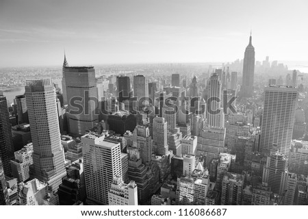 NEW YORK CITY, NY - JAN 17: Empire State Building and crowded skyscrapers on January 17, 2012 in New York City. New York is the most populous city with populuation of 8.2M in the United States - stock photo