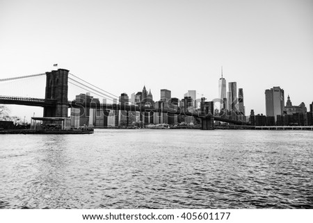 """NEW YORK CITY, NY - JANUARY 4, 2016 - A scenic view of the skyscrapers of New York City and the Brooklyn Bridge from """"Dumbo"""" a neighborhood of Brooklyn. - stock photo"""
