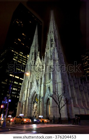 NEW YORK CITY, NY - January 8: St. Patrick's Cathedral on January 8, 2016 in New York City. Fifth Avenue has the world's most expensive retail spaces as the symbol of wealthy New York. - stock photo