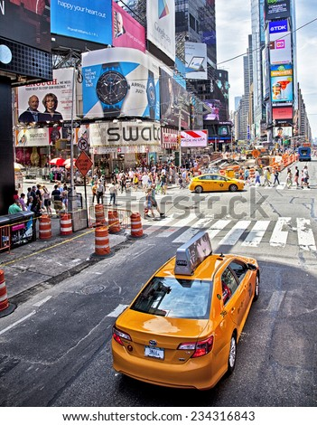 New York City, NY - June 28, 2014: Famous Times Square Theater District and taxi cabs in New York City, NY on June 28, 2014.  - stock photo