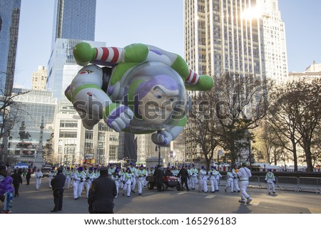 NEW YORK CITY, NY - NOVEMBER 28: Buzz Lightyear balloon flying through downtown with jetpack in the Macy's 87th Annual Thanksgiving Day Parade on November 28, 2013 in New York City, New York.  - stock photo
