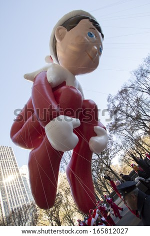 NEW YORK CITY, NY - NOVEMBER 28 : Elf on the Shelf balloon high in the sky during the Macy's 87th Annual Thanksgiving Day Parade on November 28, 2013 in New York City, New York.  - stock photo