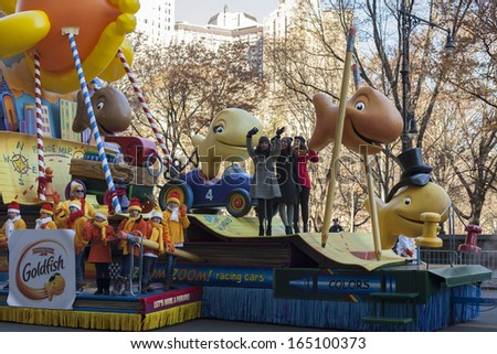 NEW YORK CITY, NY - NOVEMBER 28 : Fith Harmony on Goldfish float going through W 59th ST during the Macy's 87th Annual Thanksgiving Day Parade on November 28, 2013 in New York City, New York.  - stock photo