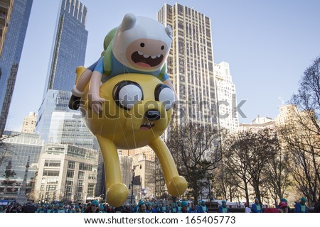 NEW YORK CITY, NY - NOVEMBER 28: Jake and Finn, from Adventure time, balloon in city for the Macy's 87th Annual Thanksgiving Day Parade on November 28, 2013 in New York City, New York.  - stock photo