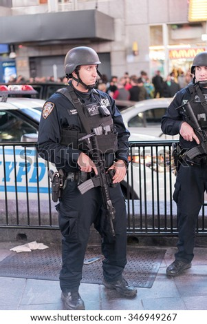 NEW YORK CITY, NY - NOVEMBER 26 : Police team in downtown Times Square on Thanksgiving evening November 26, 2015 in New York City, New York. - stock photo