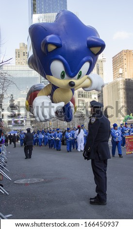 NEW YORK CITY, NY - NOVEMBER 28 : Sonic The Hedgehog balloon going through W 59th ST during the Macy's 87th Annual Thanksgiving Day Parade on November 28, 2013 in New York City, New York.  - stock photo
