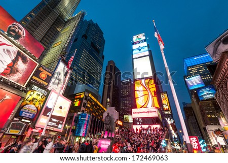 NEW YORK CITY, NY - OCT 11: Times Square on October 11, 2013 in Manhattan, New York City. It is one of the world's busiest pedestrian intersections and is the world's most visited tourist attraction. - stock photo