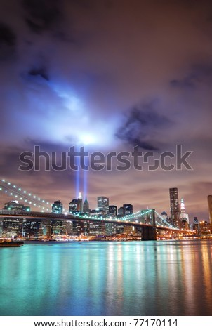 NEW YORK CITY, NY - SEP 11: Light beams are lit at the site in memory of World Trade Center destroyed on September 11. September 11, 2010 in Manhattan, New York City. - stock photo