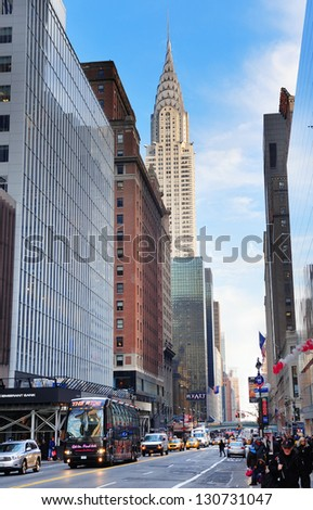 NEW YORK CITY, NY, USA - DEC 30: Chrysler Building in the day with street on December 30, 2011, New York City. It was designed by architect William Van Alena as Art Deco architecture in US. - stock photo