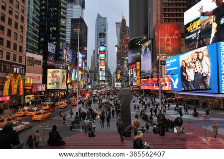 NEW YORK CITY, NY, USA - MARCH 2011: Times Square, New York City, one of the busiest and crowded street intersections in Manhattan with display of neon and LED lights on billboards and shopping malls. - stock photo