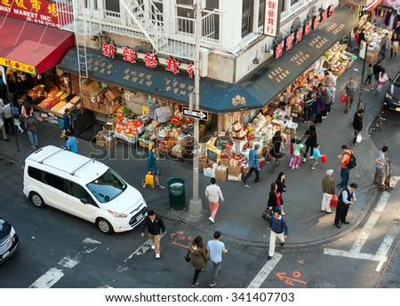 NEW YORK CITY, NY, USA - OCTOBER 11, 2015: The view from Manhattan Bridge on Chinatown - stock photo