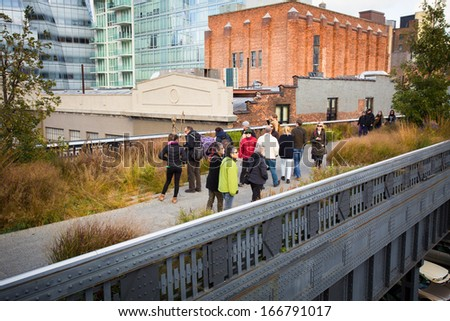 NEW YORK CITY - OCT 25: High Line Park in NYC as seen on Oct. 25, 2012. In 2009 this former elevated freight railroad spur on NYC's west side opened as an aerial park garden and continues to expand. - stock photo