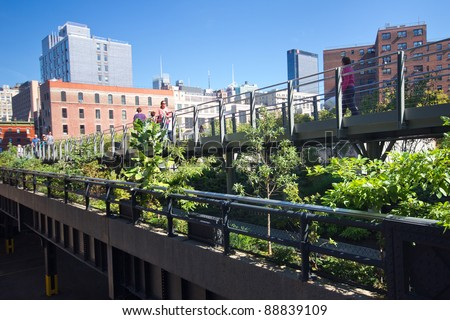 NEW YORK CITY - OCT 7:  High Line Park in NYC as seen on Oct. 7, 2011. In 2009 this former elevated freight railroad spur on NYC's west side opened as an aerial green way and continues to expand. - stock photo