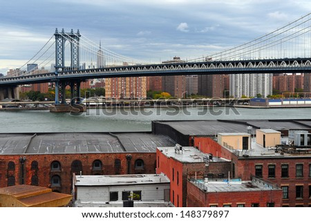 NEW YORK CITY - OCT 11:Manhattan Bridge on October 11, 2009.It's a suspension bridge that crosses the East River and connecting Lower Manhattan with Brooklyn in a total length of 6,855 ft (2,089 m). - stock photo