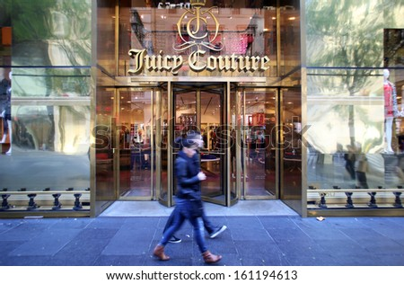 NEW YORK CITY - OCT 20, 2013: Pedestrians walk past a Juicy Couture women's clothing store on 5th Avenue in Manhattan on Sunday, October 20, 2013.  - stock photo