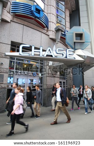 NEW YORK CITY - OCT 17:  Pedestrians walk past an JP Morgan Chase Bank, N.A. branch in Manhattan on Thursday, October 17, 2013.  - stock photo