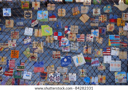 NEW YORK CITY - OCT 7: Tiles For America - Fence on Greenwich Avenue and 11th Street that holds tiles as a memorial to World Trade Center attacks on September 11th, 2001 in New York  on Oct 7, 2011 - stock photo