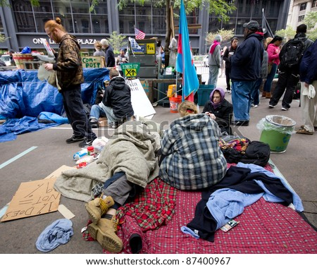 NEW YORK CITY - OCT. 21:  Unidentified protesters at Occupy Wall Street demonstration in NYC's Zuccotti Park on Oct 21, 2011.  The protest began on Sept 17. - stock photo