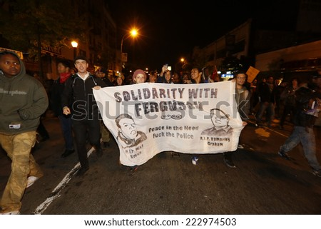 NEW YORK CITY - OCTOBER 11 2014: Activists from Take Back the Bronx staged a rally at Hunt's Point & march to the Grand Concourse in solidarity with renewed protests in Ferguson, Missouri - stock photo