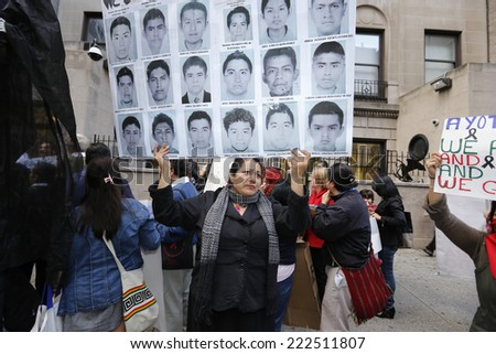 NEW YORK CITY - OCTOBER 8 2014: activists protested in front of the Mexican consulate demanding the Mexican government account for the kidnapping and murder of 43 students from the Ayotzinpapa school - stock photo