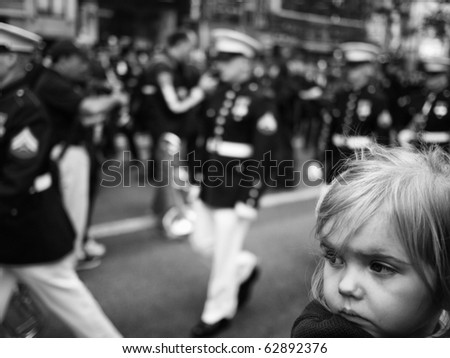 NEW YORK CITY - OCTOBER 11: An unidentified young girl watches the Columbus Day Parade on Fifth Avenue on October 11, 2010 in New York City. - stock photo