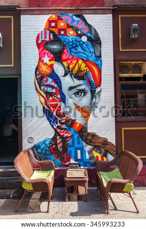 NEW YORK CITY-OCTOBER 09, 2015: Audrey Hepburn mural with unidentified people. Its part of the L.I.S.A Project that brings artists together in Little Italy creating Manhattans only mural arts district - stock photo