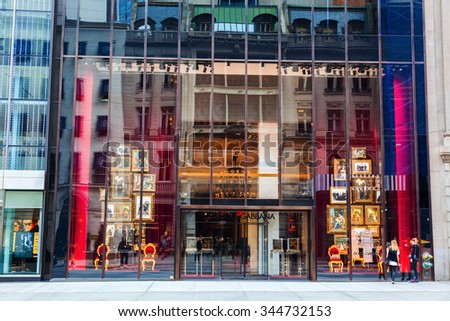 NEW YORK CITY - OCTOBER 07, 2015: Dolce and Gabbana store at 5th Avenue with unidentified peopple. Dolce and Gabbana founded in 1985 in Legnano by Italian designers Domenico Dolce and Stefano Gabbana - stock photo