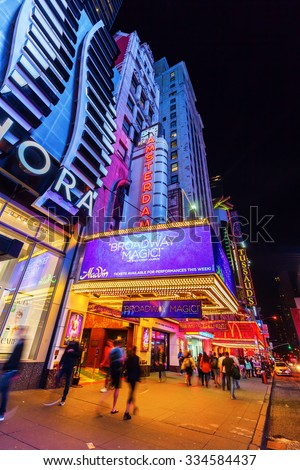 NEW YORK CITY - OCTOBER 08, 2015: New Amsterdam Broadway Theater at night. Located in Theater District of Manhattan, built in 1902â??1903, designed by architecture firm of Henry Hertz and Hugh Tallant - stock photo