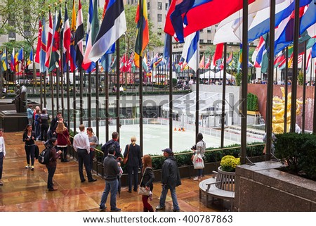 NEW YORK CITY - OCTOBER 16, 2014: people standing around looking down on the ice skating rink at the Rockefeller Plaza on Manhattan - stock photo