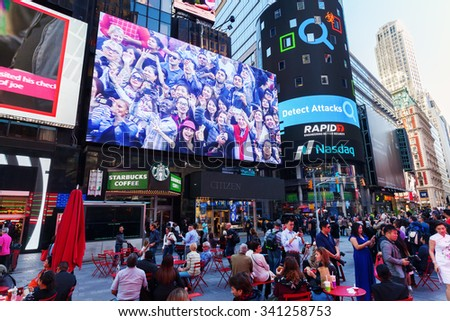 NEW YORK CITY - OCTOBER 06, 2015: Times Square with unidentified people. It is one of the worlds busiest pedestrian intersections and a major center of worlds entertainment industry - stock photo