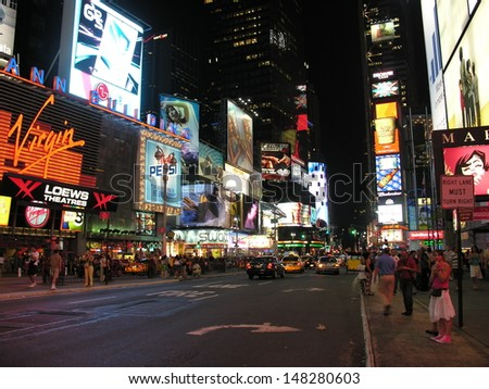 NEW YORK CITY - SEP 29: Lights and advertisements of Times Square at night, September 29, 2006 in New York City. Times Square is  a major center of the world's entertainment industry - stock photo