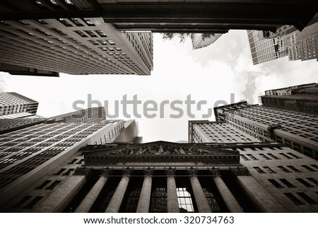 NEW YORK CITY - SEP 5: Wall Street with skyscrapers on September 5, 2014 in Manhattan, New York City. Wall Street financial district, has been called the world's principal financial center. - stock photo