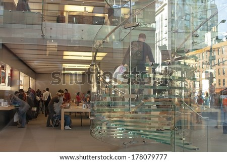 NEW YORK CITY -SEPT 23:  Interior of the  Apple Store  on 5th Avenue, New York, Sept 23,2008. As of July 2013, Apple has 411 retail stores in 14 countries - stock photo