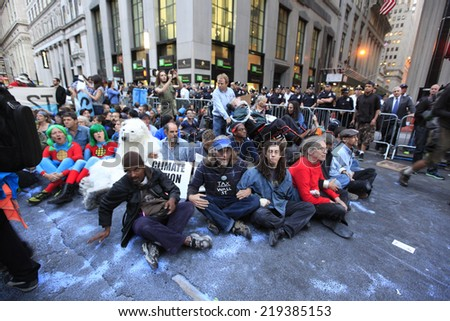 NEW YORK CITY - SEPTEMBER 22 2014: Flood Wall Street demonstrators marched from Battery Park, for a sit down at Broadway & Morris St, before preceding up to Wall Street itself where NYPD made arrests. - stock photo