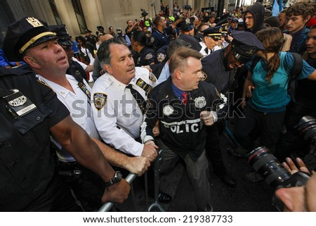 NEW YORK CITY - SEPTEMBER 22 2014: Flood Wall Street demonstrators marched from Battery Park to Broadway & Morris St for a sit down before proceeding to Wall St where NYPD made numerous arrests - stock photo