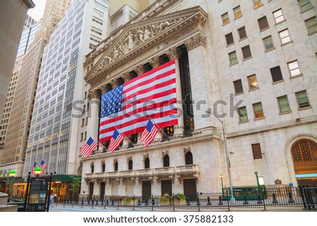 NEW YORK CITY - September 5: New York Stock Exchange building on September 5, 2015 in New York. The NYSE trading floor is located at 11 Wall Street. - stock photo