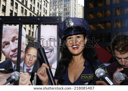 NEW YORK CITY - SEPTEMBER 17 2014: Occupy Wall Street marked the third anniversary of its founding as several dozen activists gathered in Zuccotti Park. Activist Marnie Halassa in police uniform - stock photo